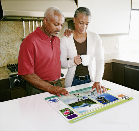 Couple using computer in table Stock Photo - 107910539