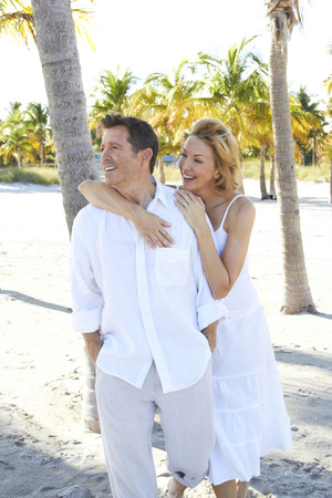 Caucasian couple walking on tropical beach