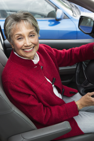 Mixed race woman driving in car