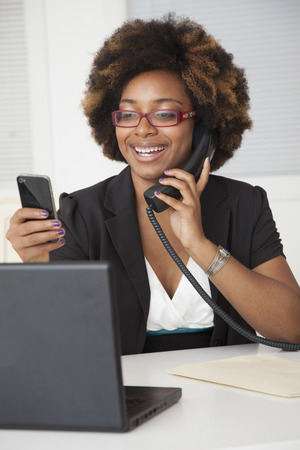 African American businesswoman working at desk