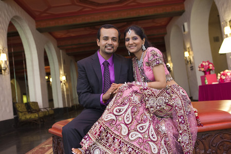 Indian newlywed couple smiling Stock Photo