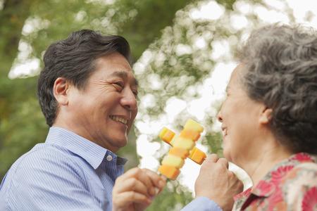 Older Chinese couple eating ice cream Stock Photo