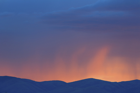 Colourful sunset over rural mountains