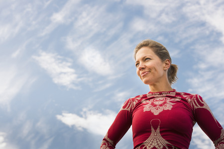 Caucasian woman standing under blue sky
