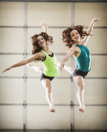 Dancers leaping in studio