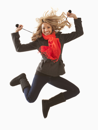 Mixed race woman jumping for joy Stock Photo
