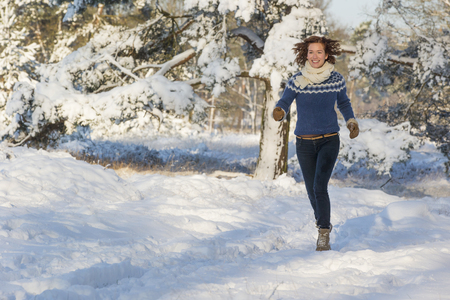 Caucasian woman walking in snow Stock Photo