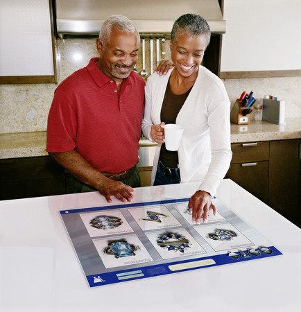 Couple using computer in table Stock Photo