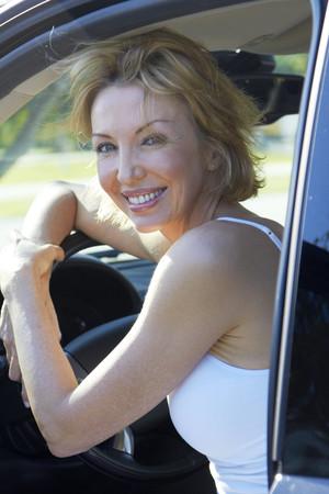Caucasian woman smiling in drivers seat