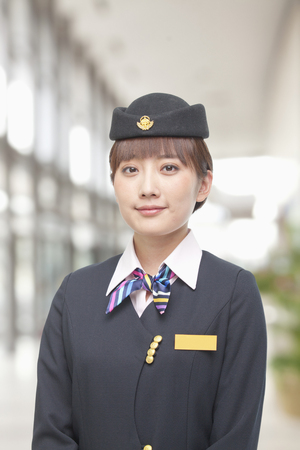 Smiling Chinese flight attendant