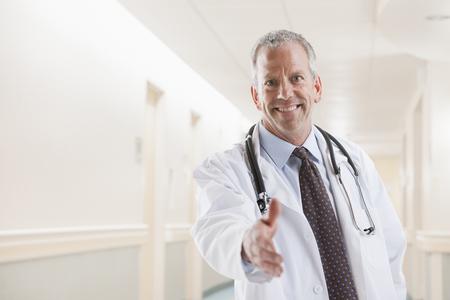 Caucasian doctor offering handshake