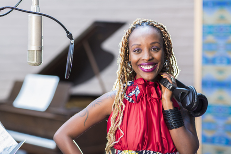 African American singer smiling in studio Stok Fotoğraf