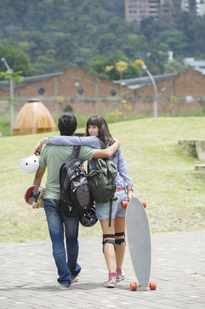 Hispanic couple walking outdoors Stock Photo