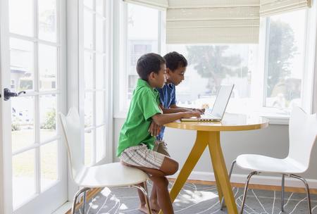 Hispanic boys using laptop Stock Photo