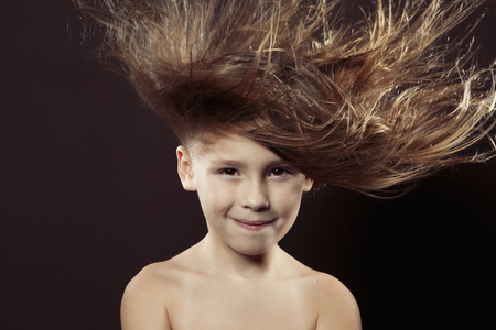 Caucasian girl with hair blowing in wind