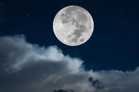 Full moon and white clouds on the sky.