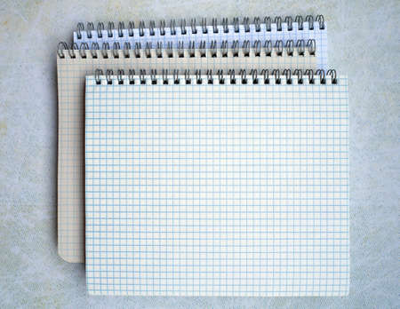 Three spiral binding notebooks are stacked. They are open. You can write text on a blank sheet. Stok Fotoğraf