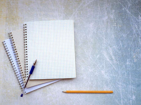 A stack of open notebooks. The handle is on top. Pencil at the bottom of the background. You can write text on a blank copybook sheet and on the background. Education concept. Stok Fotoğraf