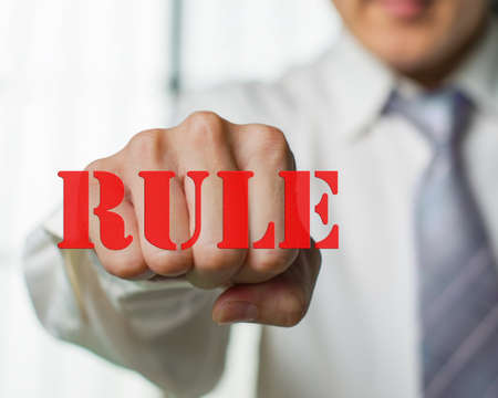 libertarian: A business man want to break the rule for new chance Stock Photo