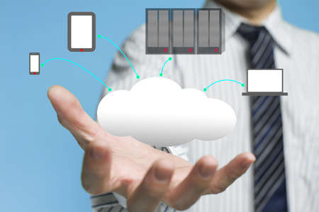 Cloud computing service concept with a business man and blue background photo