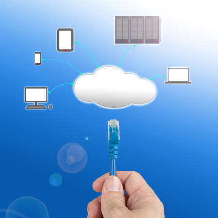 Officeman hold  Network cable  connect to cloud computing service with blue background Stock Photo - 22023426