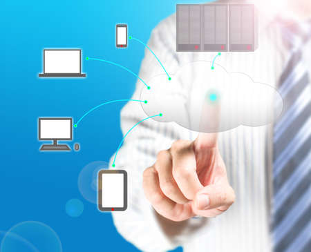 Cloud computing service with a business man and  blue background Stock Photo - 22023427