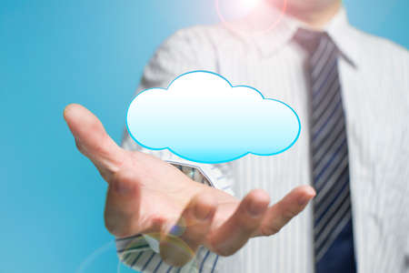 Cloud computing service concept a palm opening businessman with cloud Stock Photo - 22410876