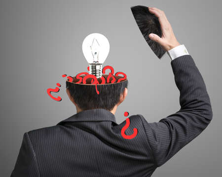 filled out: Filled out question inside business head with lamp pop out on gray background