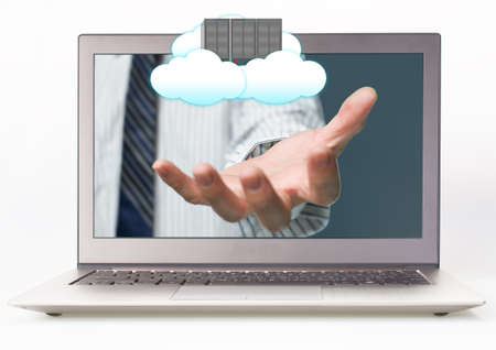 Businessman outstretch hand from Laptop with Palm opening and cloud computing server Stock Photo - 22417462