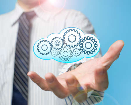 palm opening businessman with cloud fill with gears cloud computing service concept Stock Photo - 22417411