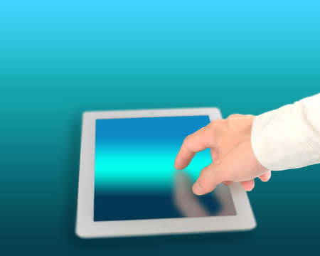 Man touching digital tablet with technology color background, close up Stock Photo - 22417419