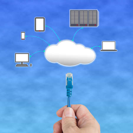 Officeman hold  Network cable  connect to cloud computing server in blue sky photo