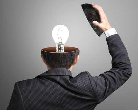 Single lighting lamp inside businessman head in gray background Stock Photo - 22410893