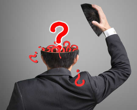 filled out: Filled out question inside businessman head with pop out big one in gray background