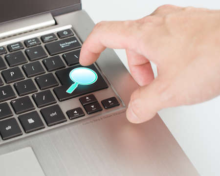 Bright blue magnifier draw search button on the keyboard close-up Stock Photo - 22410919