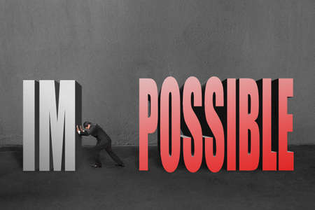 infeasible: Businessman push word  impossible  im away, to make it possible in concrete wall background