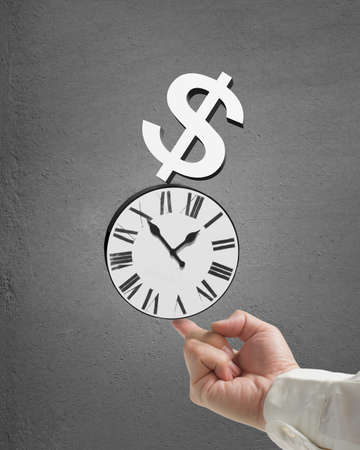 Man use index finger to balacne stacked clock and money in concrete background Stock Photo
