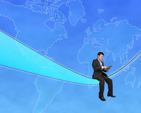 Businessman sitting on a tech cable and touch tablet with global map background in blue sky photo