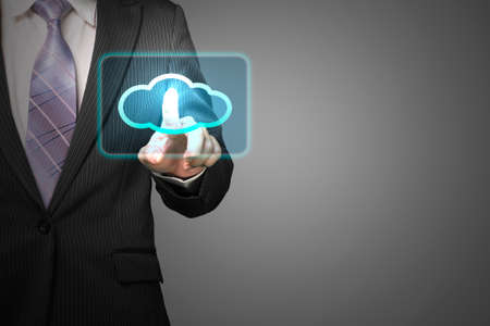 Cloud computing service concept, businessman touch cloud icon in space for launching service in gray background Stock Photo