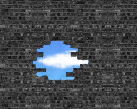 Broken bricks wall with a big hole and cloud, blue sky outside