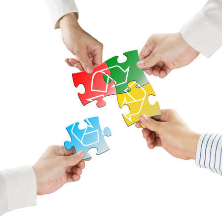 Hands hold puzzles with recycle symbol isolated in white background