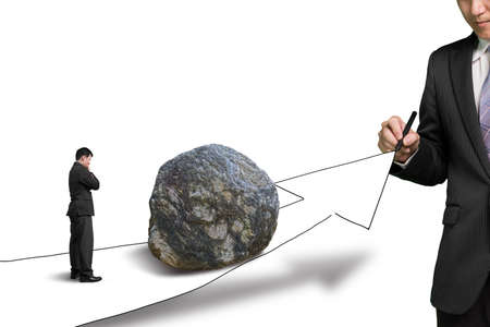 hinder: Businessman drawing road with growth arrow and large rock on the way the other standing toward the rock and thinking  Stock Photo
