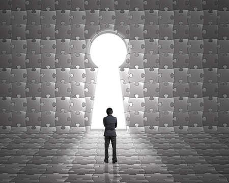 key hole shape: Businessman stand toward key hole shape door on puzzles wall with bright outside background