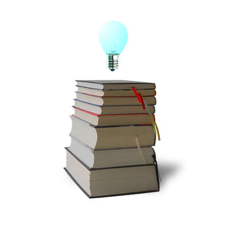 Glowing bulb on top of stack books on white background photo