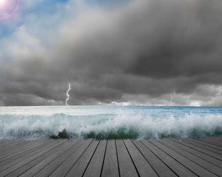 Pier flooded by waves with cludy sky, Lightning in dangerous situation Stock Photo - 23777376