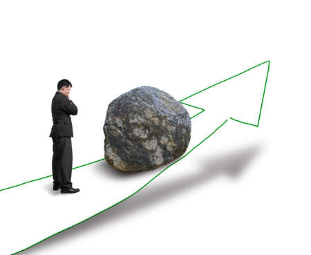 Businessman thinking and standing against large rock on the way in white background