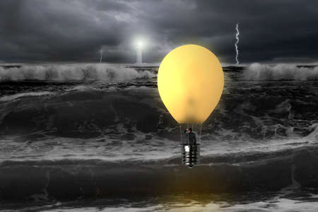 Man taking glowing lamp balloon with dramatic ocean, lightning and lighthouse , dangerous situation photo