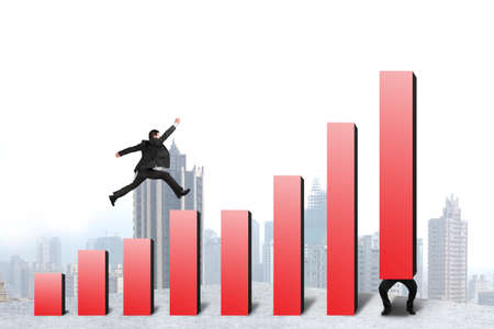 Businessman running and jumping on red bar chart another lift one with city background photo