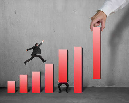 Businessman running and jumping on red bar chart another lift one, hand hold one bar