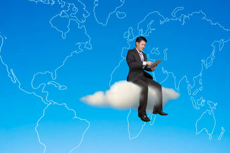 Businessman using tablet and sitting on cloud with global map in sky background photo